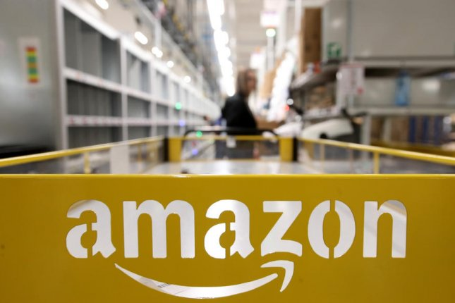 Amazon has previously hired 200,000 new permanent and temporary workers this year since the outbreak of COVID-19. File Photo by Friedemann Vogel/EPA-EFE