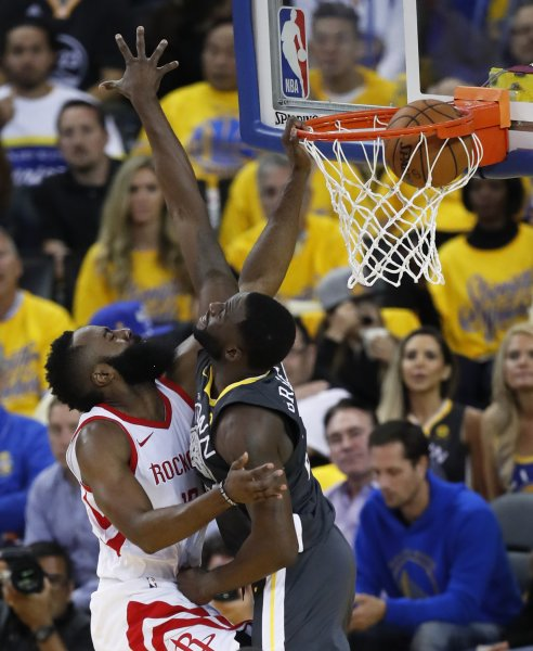 Houston Rockets guard James Harden (L) dunks on Golden State Warriors forward Draymond Green during the Western Conference Finals on Tuesday at Oracle Arena in Oakland, Calif. Photo by John G. Mabanglo/EPA-EFE/Shutterstock