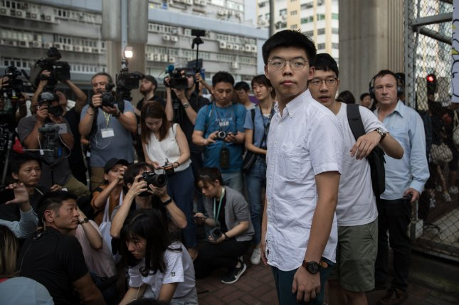 Hong Kong pro-democracy activist Joshua Wong has been barred from running in November's district elections due to his support of self-determination. Photo by Jerome Favre/EPA-EFE