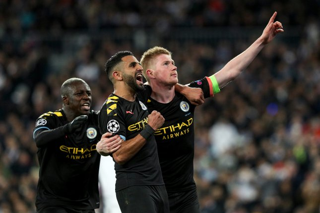Manchester City's Kevin De Bruyne (R) scored the go-ahead goal on a penalty kick in the Sky Blues' win against Real Madrid in the Champions League Wednesday in Madrid. Photo by Rodrigo Jimenez/EPA-EFE