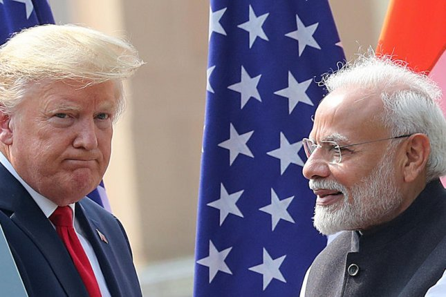 Indian Prime Minister Narendra Modi stands with U.S. President Donald Trump on Tuesday after a meeting at Hyderabad House in New Delhi, India. Photo by Harish Tyagi/EPA-EFE