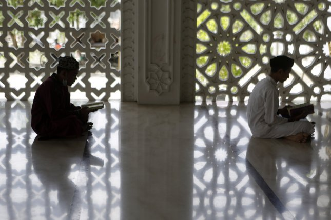 Two teenagers read and memorize the Koran during Ramadan at a mosque in Banda Aceh, Indonesia, on Tuesday. Photo by Hotly Simanjuntak/EPA-EFE