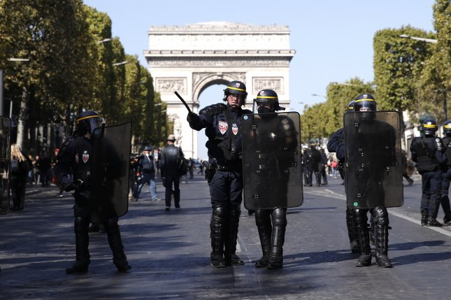 French riot Police secure a street near the Champs Elysees during the the yellow vest protest Saturday. Photo by Yoan Valat/EPA-EFE