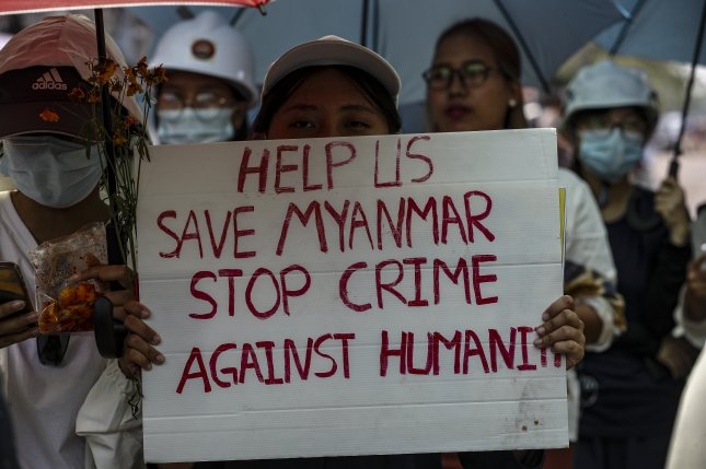 Demonstrators display placards during a protest against the military coup in the outskirts of Yangon, Myanmar, in March. The European Union on Monday imposed its third round of sanctions since the junta seized control of the government Feb. 1 in a coup. Photo by EPA-EFE