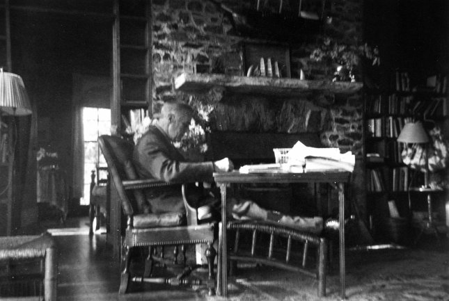 President Franklin D. Roosevelt at his work table near the hearth at the Little White House in Warm Springs, Ga. This photo was taken by his friend Margaret Daisy Suckley, a few days before he died on April 12, 1945. File Photo courtesy FDR Presidential Library