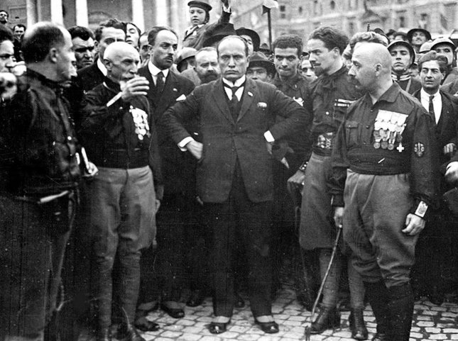 Benito Mussolini (C) in October 1922, during the fascists March on Rome. Photo courtesy Wikipedia