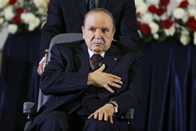 Algerian President Abdelaziz Bouteflika, re-elected for a fourth mandate, reacts during the oath-taking ceremony in Algiers, Algeria, on April 28, 2014. The former president died at the age of 84 on Friday. File Photo by Mohamed Messara/EPA-EFE