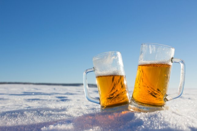 A couple of cold beers chilled by the snow. An audit from the National Science Federation found scientists in Antarctica might be enjoying too many similar beverages. Photo by Igor Bukhlin/Shutterstock.com
