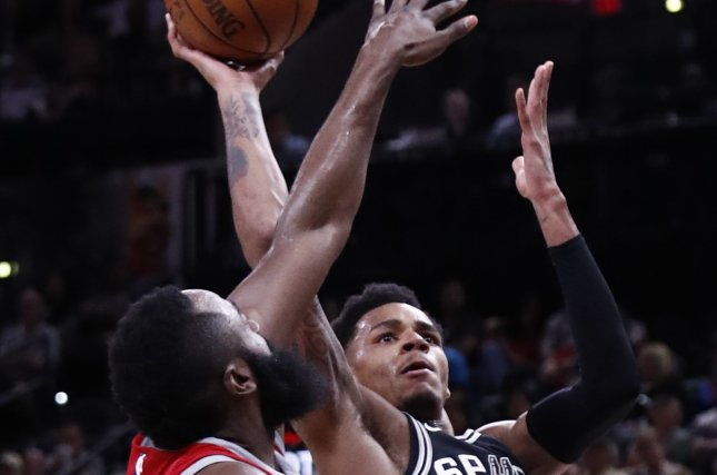 941370bf84a3 Houston Rockets star James Harden (L) tries to block a shot against San  Antonio Spurs guard Dejounte Murray (R) in the second half of an NBA  basketball game ...