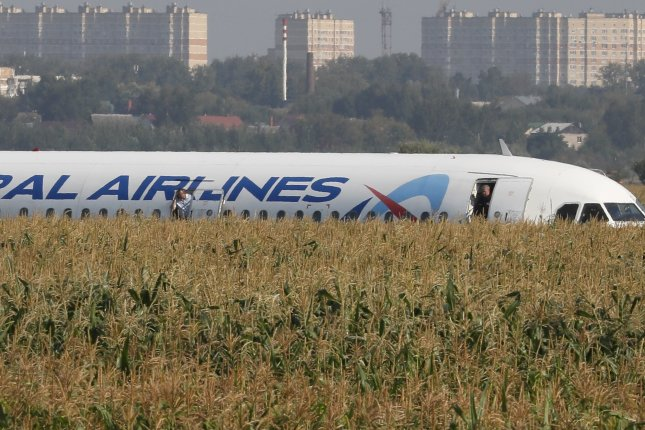 Russian airliner crash lands in cornfield outside Moscow