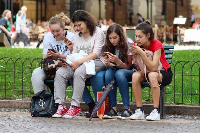 Researchers say parents don't need to be too concerned about the amount of time teens spend on smartphones -- they're aware and thinking about it. Photo by ghcassel/Pixabay