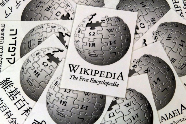 On January 15, 2001, free online encyclopedia Wikipedia debuts, giving users the ability to create and edit articles. File Photo by Boris Roessler/EPA