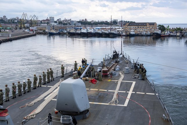 Sailors aboard the USS Laboon man the rails as the Arleigh Burke-class guided-missile destroyer pulls into port in Romania on June 18. Photo courtesy of the U.S. Navy