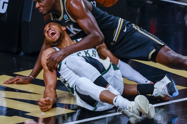 Milwaukee Bucks forward Giannis Antetokounmpo (L) is injured during a play involving Atlanta Hawks center Clint Capela (R) in the second half of Game 4 of the NBA Eastern Conference Finals on Tuesday at State Farm Arena in Atlanta. Photo by Erik S. Lesser/EPA-EFE