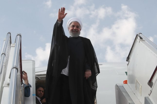 Iranian President Hassan Rouhani waves Sunday as he boards a plane at the Mehr-Abad airport in Tehran en route to New York to attend the 73rd United Nations General Assembly. Photo by Presidential Office/EPA