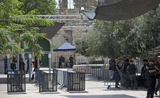 Israeli policeman patrol outside Lions' Gate, the main the entrance to the Al-Aqsa compound next to metal detectors in Jerusalem. The Israeli government announced Monday it would remove the metal detectors for other security measures. Photo by EPA/Atef Safadi