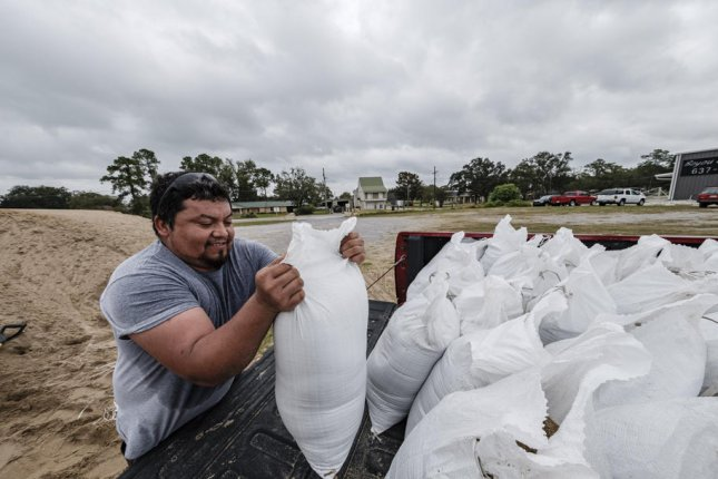 Resident Francisco Chan loads sandbags into his truck on Thursday to prepare for Hurricane Delta, in Houma, La. The storm is expected to arrive over land later Friday as a major hurricane. Photo by Dan Anderson/EPA-EFE