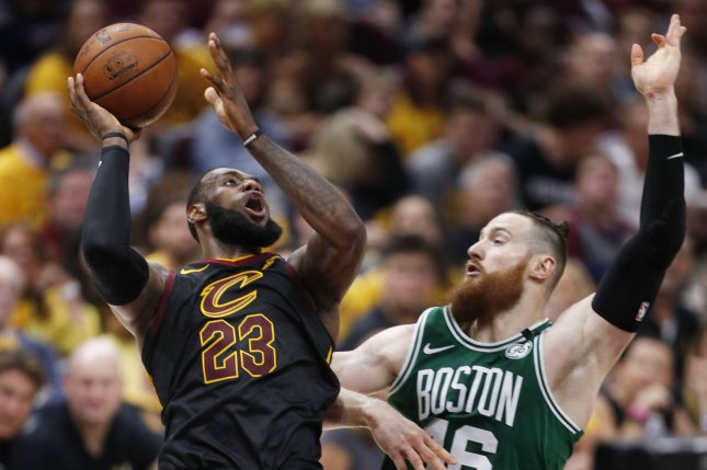LeBron James (23) of the Cleveland Cavaliers gets a shot off against Boston Celtics center Aron Baynes during the second half of Game 3 of the Eastern Conference finals Saturday at Quicken Loans Arena in Cleveland, Ohio. Photo by David Maxwell/EPA-EFE/Shutterstock
