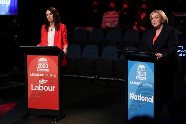 Labor Party's Prime Minister Jacinda Ardern (L) and leader of the National Party Judith Collins (R) debate in Auckland, New Zealand, on September 30. New Zealand is slated to hold its general election on Saturday. Pool Photo by Michael Bradley/EPA-EFE