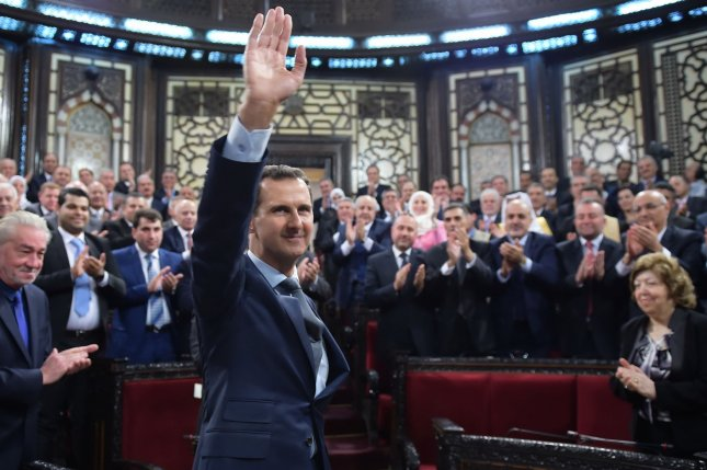 Syrian President Bashar Assad, seen here in June after speaking to the Syrian parliament, told NBC News Russia's support in the civil war has tipped the scales in favor of victory. He said he is uninterested in U.S. politics. Photo by SANA/UPI