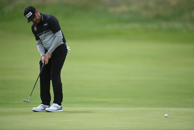 Louis Oosthuizen of South Africa putts on the seventh hole during the first round of The British Open golf championship on Thursday at Royal St. George's in England. Photo by Neil Hall/EPA-EFE