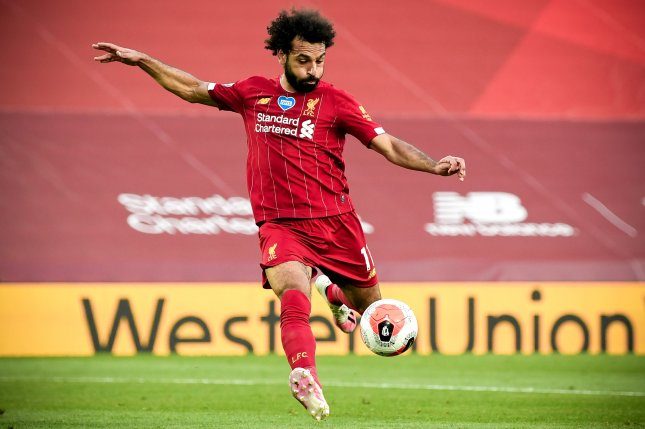 Liverpool and star striker Mohamed Salah battle Real Madrid in the 2020-21 Champions League quarterfinals. Photo by Shaun Botterill/EPA-EFE