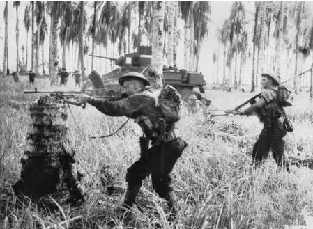 Australian-manned M3 General Stuart tanks attack Japanese pillboxes in the final assault on Buna, Papua New Guinea, on January 2, 1943. File Photo by George Silk/Australian government