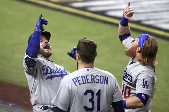Los Angeles Dodgers first baseman Max Muncy (L) celebrates with teammates Joc Pederson (C) and Justin Turner after hitting a solo home run against the Tampa Bay Rays during the fifth inning in Game 5 of the World Series on Sunday night at Globe Life Field in Arlington, Texas. Photo by Tannen Maury/EPA-EFE