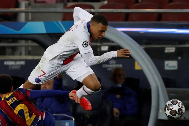 Paris Saint-Germain forward Kylian Mbappe (R) on Tuesday became the first player in history to score three goals against Barcelona in a knockout stage match at the UEFA Champions League. Photo by Alberto Estevez/EPA-EFE