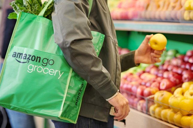 A shopper is seen in one of Amazon's Go Grocery stores, which features what the company calls Just Walk Out Technology. A similar store opened in Britain for the first time on Thursday. File Photo courtesy Amazon