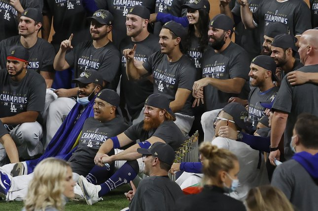 Los Angeles Dodgers third baseman Justin Turner (C, bottom with red beard) returned to the field to celebrate with teammates after the Dodgers won the World Series in Game 6 last month. He was removed from that game after a positive COVID-19 test. File Photo by John G. Mabanglo/EPA-EFE