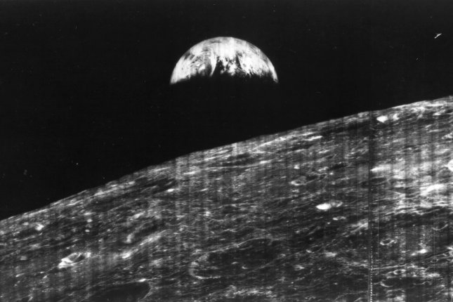 The first photograph of the Earth from the distance of the moon taken by Lunar Orbiter 1 on August 23, 1966. The unmanned spacecraft began orbiting the moon. File Photo courtesy of NASA