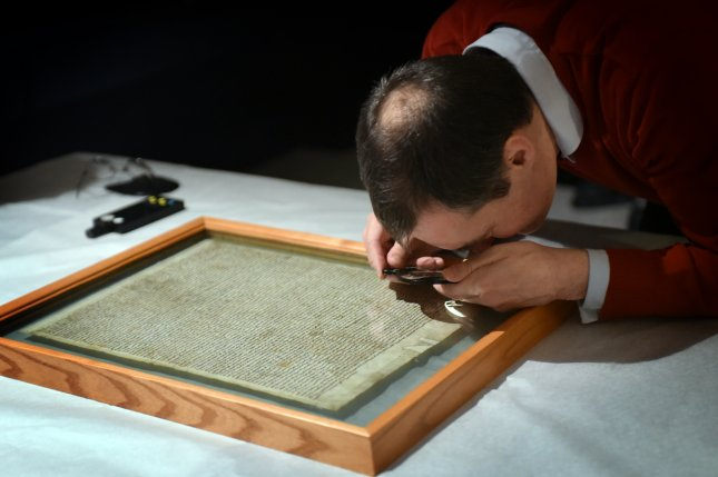 The four original Magna Carta manuscripts being prepared for display at the British Library. Photo courtesy of the British Library.