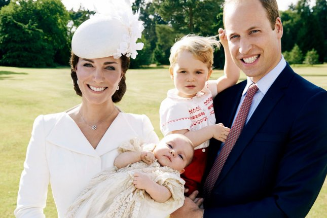 The Duke and Duchess of Cambridge, William and Kate Middleton, pose with their children, Prince George and Princess Charlotte, on the day of her christening on Sunday, July 5, 2015. File Photo courtesy of The British Monarchy.
