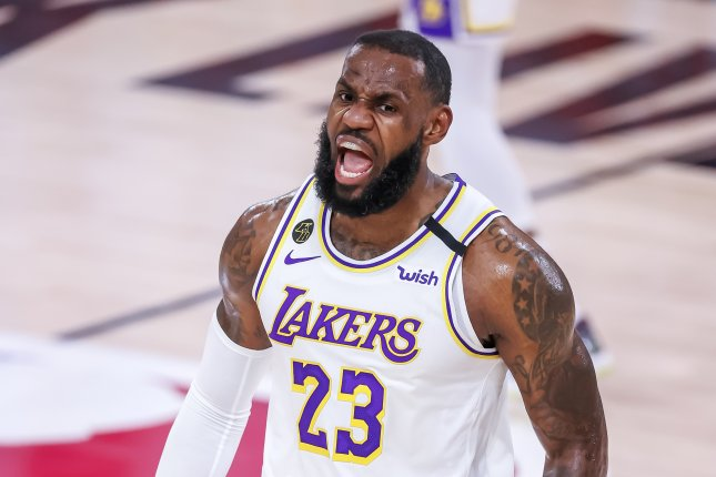 LeBron James and the Los Angeles Lakers battle the Miami Heat in Game 5 of the NBA Finals on Friday night. The Lakers can clinch their 17th NBA title in franchise history with a win. File Photo by Erik S. Lesser/EPA-EFE
