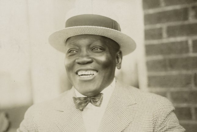 On December 26, 1908, Jack Johnson, with a 14th-round KO of Tommy Burns in Australia, became the first African-American to win the world heavyweight boxing title. File Photo by Library of Congress