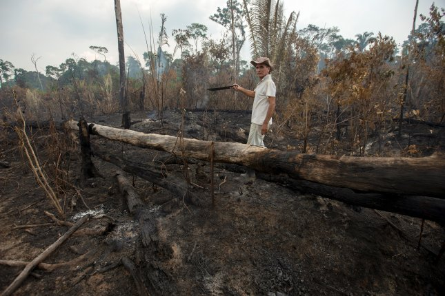 Rancher Helio Lobardo shows the destruction on his farm by one of the fires in the Amazon rainforest on Tuesday. He believes the fires were intentionally set. Photo by Joedson Alves/EPA-EFE