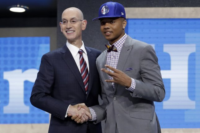 Orlando Magic guard Markelle Fultz (R), shaking hands with NBA commissioner Adam Silver, was drafted by the Philadelphia 76ers with the first overall pick in 2017. But injuries and inconsistency have his pro career off to a less-than-stellar start. File Photo by Jason Szenes/EPA