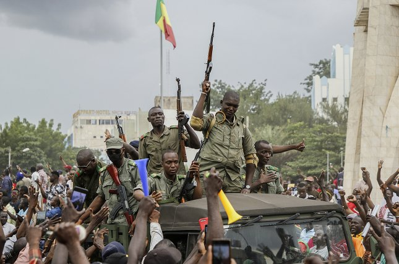 Malians cheer as Mali military enters the streets of Bamako, Mali, Tuesday. Photo by Moussa Kalapo/EPA-EFE
