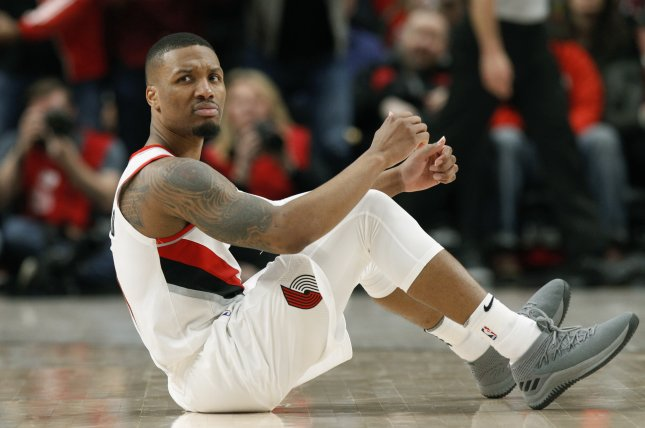 Portland Trail Blazers guard Damian Lillard (pictured) dropped a diss track Tuesday that aimed at Shaquille O'Neal and his championships. File Photo by Steve Dipaola/EPA-EFE