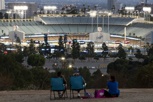 Fans were forced to watch the Los Angeles Dodgers and San Francisco Giants game from outside of Dodger Stadium Thursday due to the coronavirus pandemic. Photo by Etienne Laurent/EPA-EFE