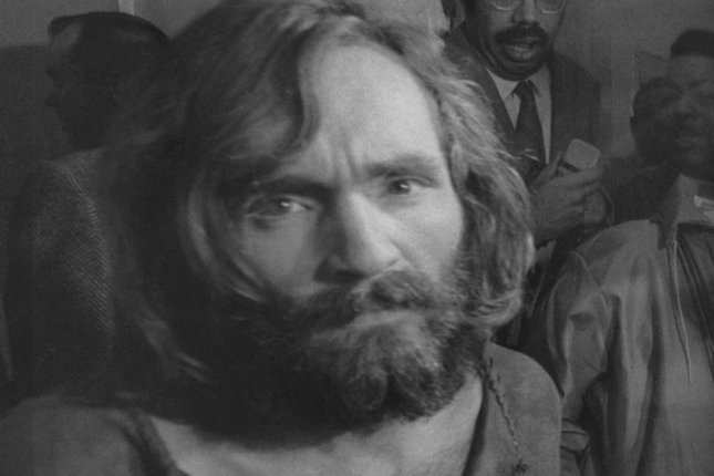 Charles Manson is taken into custody at the Los Angeles jail in 1969 after being charged, and later convicted, with the murders of actress Sharon Tate, her unborn child and several friends. File Photo by Ernie Schwork/UPI