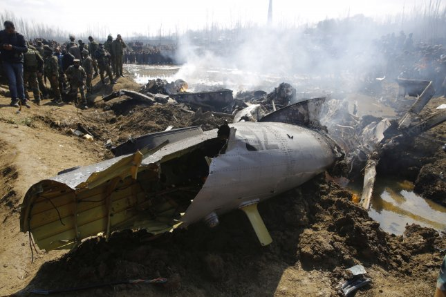 Indian army soldiers stand near the wreckage of the aircraft after it crashed in central Kashmir's Budgam district. Pakistan has said it has shot down two Indian aircraft. Photo by Farooq Khan/EPA-EFE