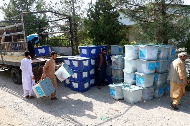 Election workers move ballot boxes to an Independent Election Commission warehouse on September 29, a day after presidential elections, in Herat, Afghanistan. Photo by Jalil Rezayee/EPA-EFE