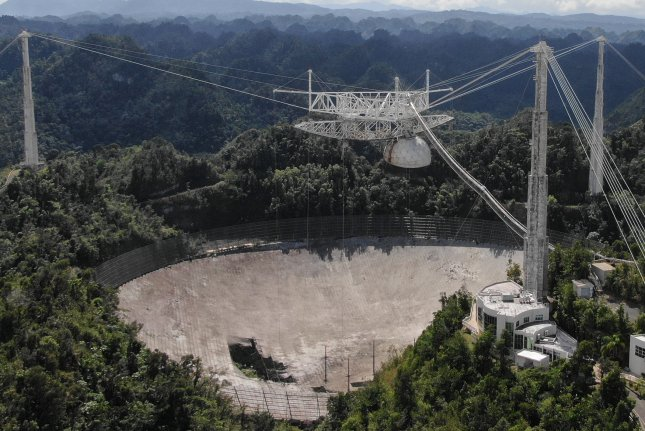 A damaged radar dish is shown in a photo taken by a drone after a main cable broke at the Arecibo Observatory in Puerto Rico on Nov. 6, 2020, Photo courtesy of University of Central Florida
