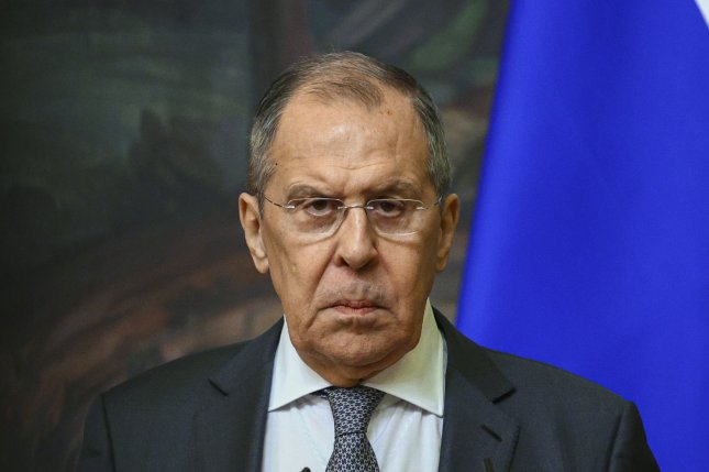 Russian Foreign Minister Sergei Lavrov attends a press conference with Afghanistan's foreign minister Mohammad Hanif Atmar on February 26. Lavrov said Friday Russia was expelling 10 U.S. diplomats in response to President Joe Biden's sanctions against Russia. Photo by Russian Foreign Ministry Press Service/EPA-EFE