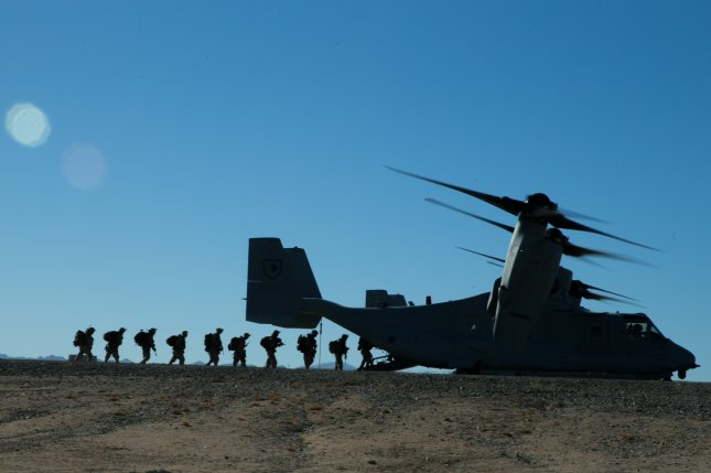 U.S. Marines with 2nd Battalion, 5th Marine Regiment, 1st Marine Division, board an MV-22 Osprey aircraft during exercise Steel Knight 2018 at Marine Corps Air Ground Combat Center, Twentynine Palms, Calif., Dec. 7, 2017. Photo by Lance Cpl. Alexa M. Hernandez/U.S. Marine Corps