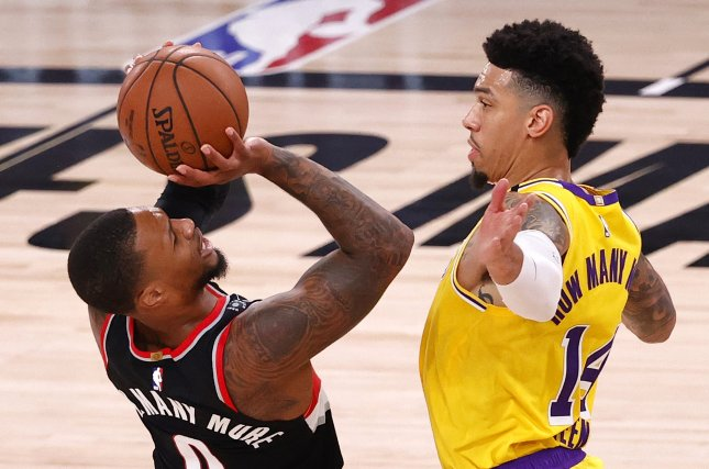 Portland Trail Blazers guard Damian Lillard (L) may not return to the NBA's protective Walt Disney World Resort bubble after he injured his knee in Game 4 of a playoff series against the Los Angeles Lakers on Monday in Orlando, Fla. Photo by John G. Mabanglo/EPA-EFE