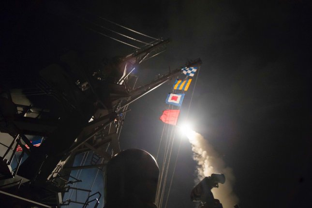 The USS Ross fires a tomahawk cruise missile into Syria on April 7, 2017, in response to President Bashar al-Assad's government's using sarin gas against Syrian civilians. File Photo by Robert S. Price/U.S. Navy