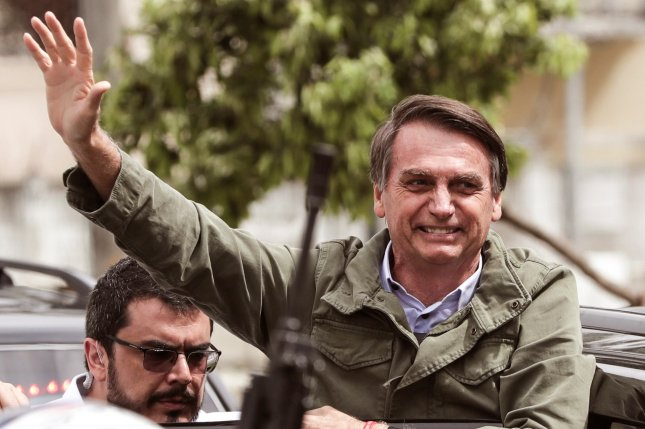 Much has been made of Jair Bolsonaro's Trump-like, anti-establishment rhetoric and flagrant disdain for minority rights, which struck a chord with a population increasingly disillusioned with politics. Photo by Antonio Lacerda/EPA-EFE